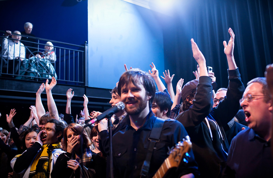 Travis Morrison of the Dismemberment Plan invites his crowd up on stage.